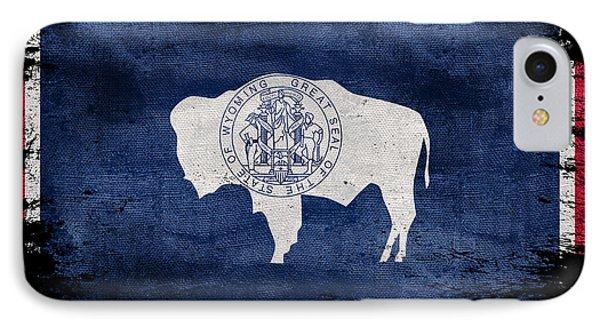 Distressed Wyoming Flag On Black IPhone Case by Jon Neidert