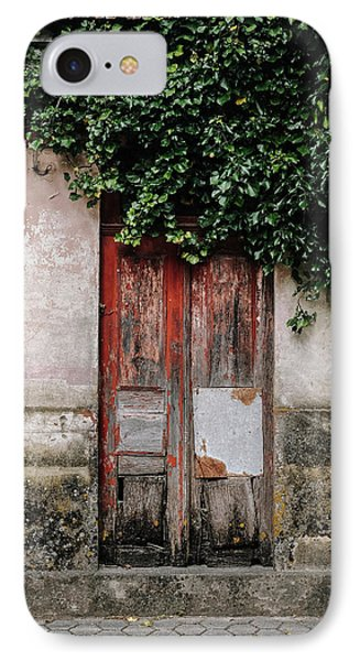 IPhone Case featuring the photograph Door Covered With Ivy by Marco Oliveira