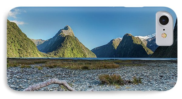 IPhone Case featuring the photograph Driftwood In Milford Sound by Gary Eason