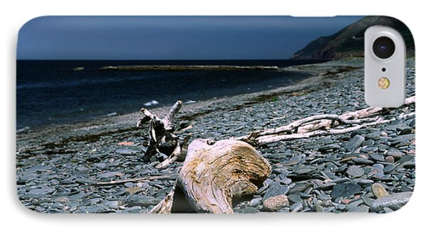 Driftwood On Rocky Beach Phone Case by Sally Weigand