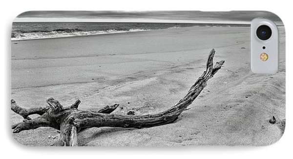 Driftwood On The Beach In Black And White IPhone Case by Paul Ward