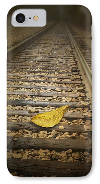 Fallen Yellow Autumn Leaf On The Railroad Tracks IPhone Case by Randall Nyhof