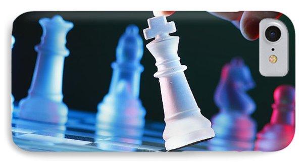 Finger Tilting A Chess Piece On Chess Board IPhone Case by Jun Pinzon