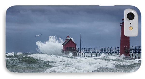 Flying Gull In A November Storm On Lake Michigan By The Grand Haven Lighthouse IPhone Case by Randall Nyhof