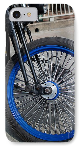 IPhone Case featuring the photograph Front Wheel With Blue Rims And Fat Chrome Spokes Of Vintage Styl by Jason Rosette