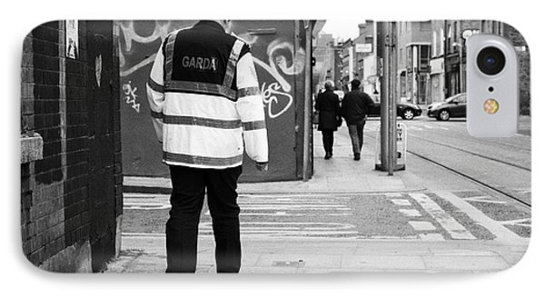 garda sergeant on foot patrol beat in dublin Ireland IPhone Case by Joe Fox