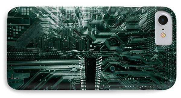 IPhone Case featuring the photograph Ginat Microchip Hovering Above Circuit-board by Christian Lagereek