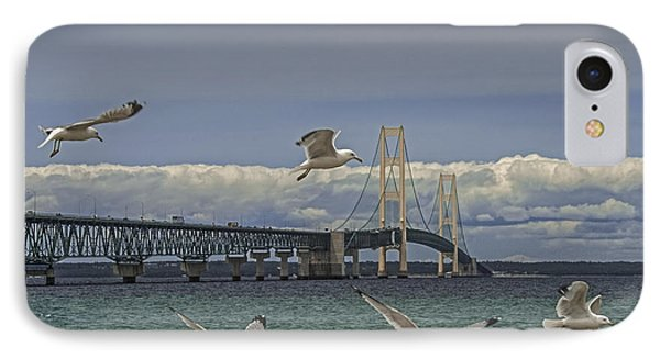 Gulls Flying By The Bridge At The Straits Of Mackinac IPhone Case by Randall Nyhof