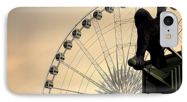 IPhone Case featuring the photograph Hanging On The Wheel by Valentino Visentini