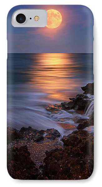 Harvest Moon Rising Over Beach Rocks On Hutchinson Island Florida During Twilight. IPhone Case by Justin Kelefas