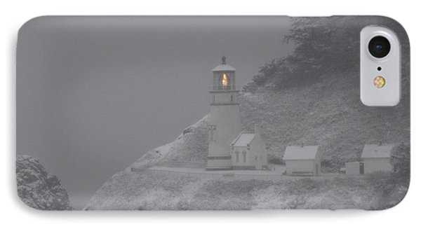 IPhone Case featuring the photograph Heceta Lighthouse Snowstorm by Kenny Henson