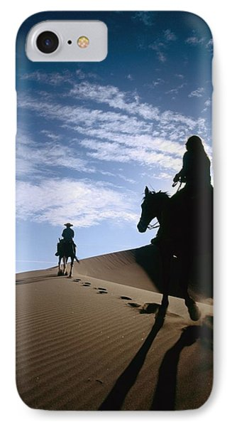 Horseback Riders In Silhouette On Sand Phone Case by Axiom Photographic
