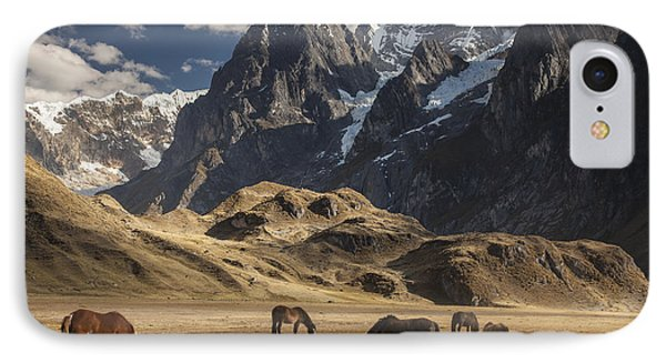 Horses Grazing Under Siula Grande IPhone Case by Colin Monteath