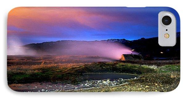 IPhone Case featuring the photograph Icelandic Geyser At Night by Dubi Roman