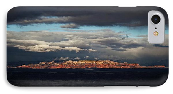 IPhone Case featuring the photograph Late Light On Red Rocks With Storm Clouds by Ron Chilston