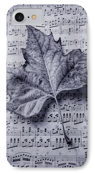 Leaf On Sheet Music In Black And White IPhone Case by Garry Gay