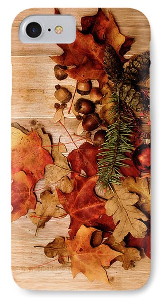 IPhone Case featuring the photograph Leaves And Nuts And Red Ornament by Rebecca Cozart
