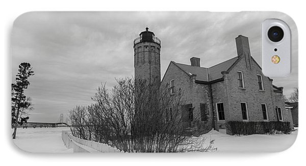 IPhone Case featuring the photograph Lighthouse And Mackinac Bridge Winter Black And White  by John McGraw