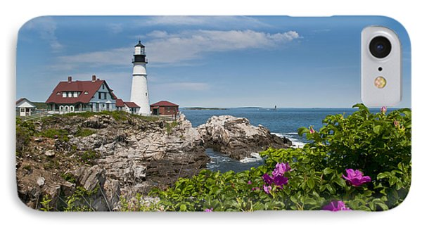 Lighthouse With Rocks On Shore Phone Case by Bill Bachmann and Photo Researchers
