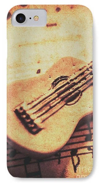 Little Carved Guitar On Sheet Music IPhone Case by Jorgo Photography - Wall Art Gallery