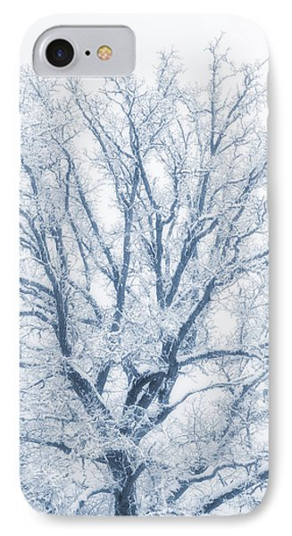 IPhone Case featuring the photograph lonely Oak tree in snowy, misty landscape by Christian Lagereek
