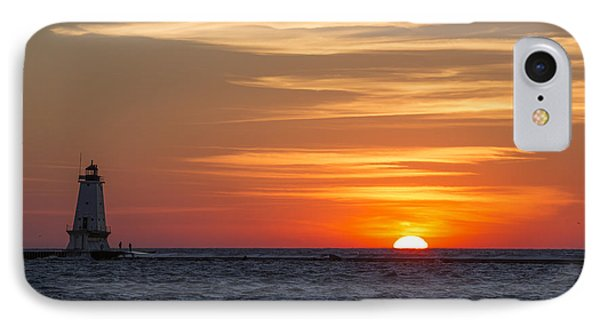 Ludington North Breakwater Light At Sunset IPhone Case by Adam Romanowicz