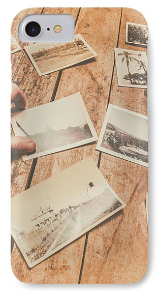 Male Hand Holding Instant Photo On Wooden Table IPhone Case by Jorgo Photography - Wall Art Gallery