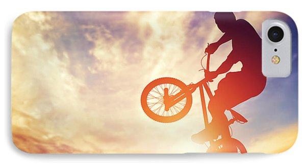 Man Riding A Bmx Bike Performing A Trick Against Sunset Sky IPhone Case