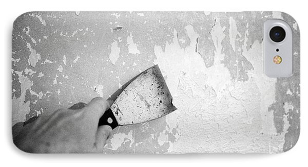 Mans Hand Stripping Paint And Wallpaper Off A Plaster Wall IPhone Case by Joe Fox