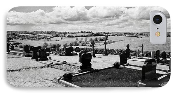 Modern Graveyard Overlooking Rural Landscape In Tydavnet County Monaghan Republic Of Ireland IPhone Case by Joe Fox