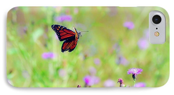 IPhone Case featuring the photograph Monarch Butterfly In Flight Over The Wildflowers by Kerri Farley