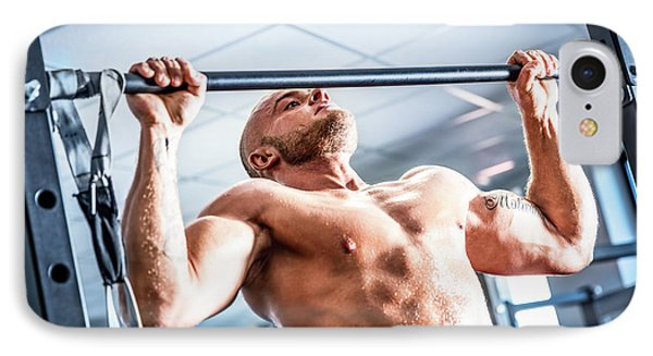 Muscular Strong Man Training At A Gym. IPhone Case by Michal Bednarek