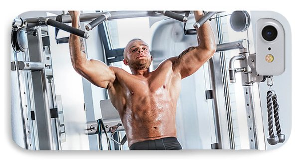 Muscular Strong Man Working Out At A Gym. IPhone Case by Michal Bednarek