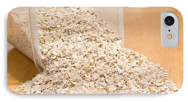 Oat Flakes Spilled Out Of Plastic Container  IPhone Case by Arletta Cwalina