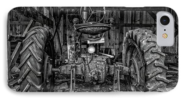 Old Tractor In The Barn Black And White IPhone Case by Edward Fielding