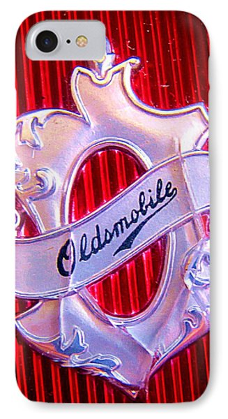 IPhone Case featuring the photograph Oldsmobile Emblem. by John King