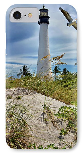 Pelican Flying Over Cape Florida Lighthouse IPhone Case by Justin Kelefas