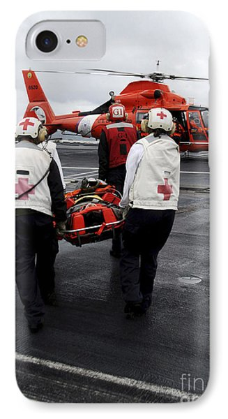 Personnel Carry An Injured Sailor Phone Case by Stocktrek Images