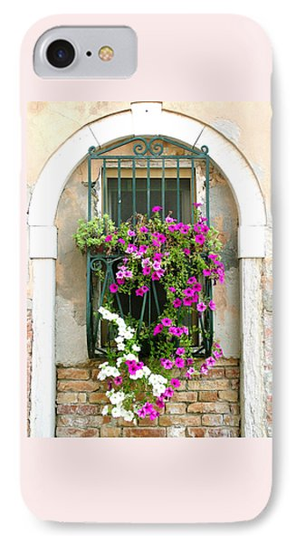IPhone Case featuring the photograph Petunias Through Wrought Iron by Donna Corless
