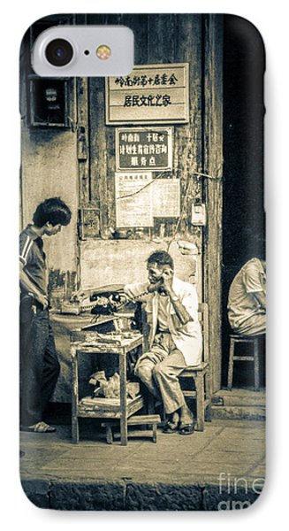 IPhone Case featuring the photograph Phonecall On Chinese Street by Heiko Koehrer-Wagner