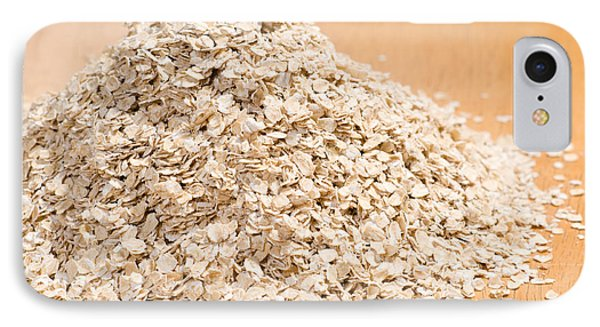 Pile Of Dried Rolled Oat Flakes Spilled  IPhone Case by Arletta Cwalina