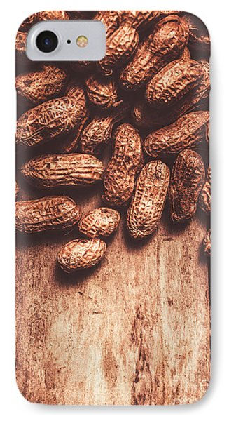 Pile Of Peanuts Covering Top Half Of Board IPhone Case by Jorgo Photography - Wall Art Gallery