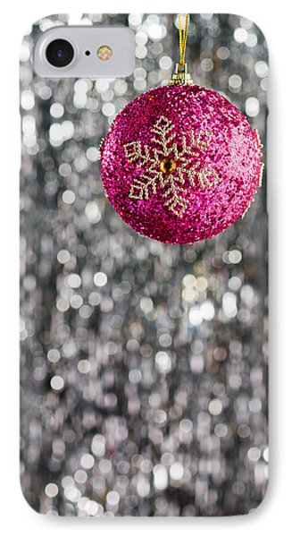 IPhone Case featuring the photograph Pink Christmas Bauble by Ulrich Schade