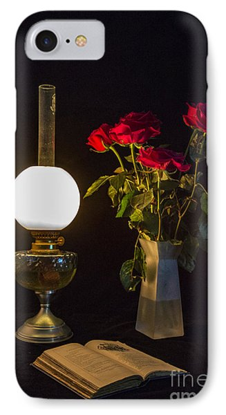 IPhone Case featuring the photograph Reading By Oil Lamp by Brian Roscorla