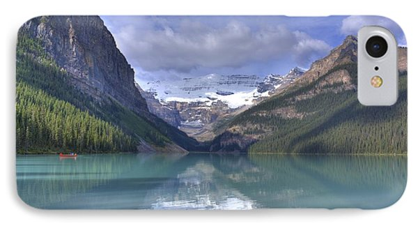 Red Canoe On Lake Louise Phone Case by Larry Whiting