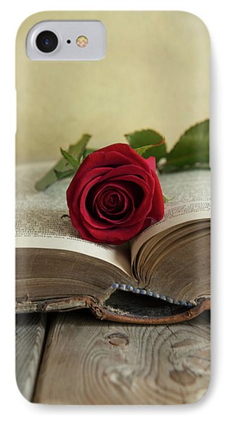 Red Rose On An Old Big Book IPhone Case by Jaroslaw Blaminsky