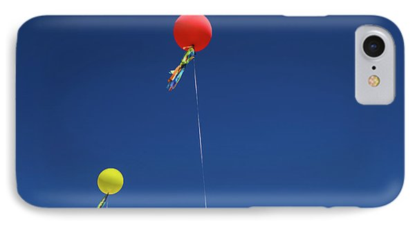IPhone Case featuring the photograph Red,yellow Balloon Blowing By The Wind In The Air With The Blue  by Jingjits Photography