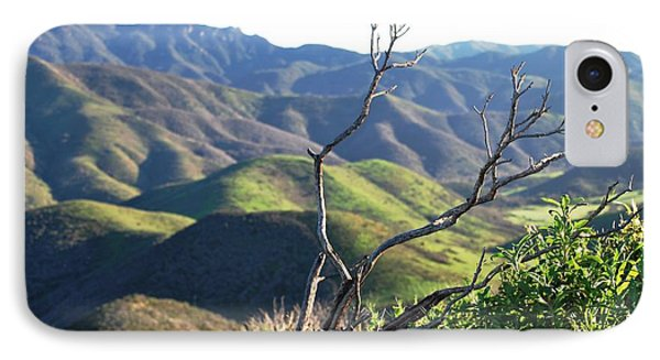 IPhone Case featuring the photograph Rolling Green Hills With Dead Branches by Matt Harang