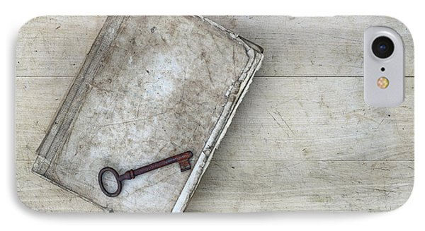 IPhone Case featuring the photograph Rusty Key On The Old Tattered Book by Michal Boubin