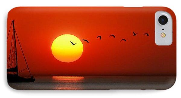 IPhone Case featuring the photograph Sailboat At Sunset by Joe Bonita